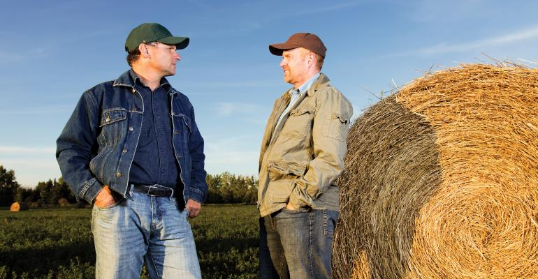 two farmers talking