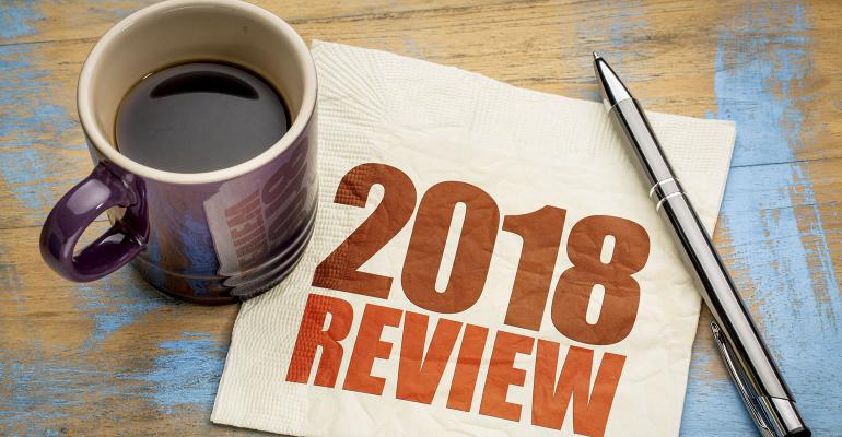 2018YearInReview- coffee cup with napkin that says 2018 Review on table