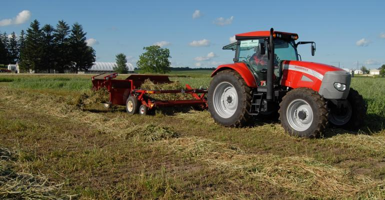 Hay equipment operating in alfalfa field