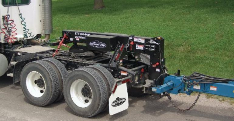 New hitch converts semi for planter, implement transport