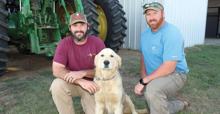 Huerkamp Farm's Brandon Huerkamp, left, Tyler Huerkamp, and their dog Knox