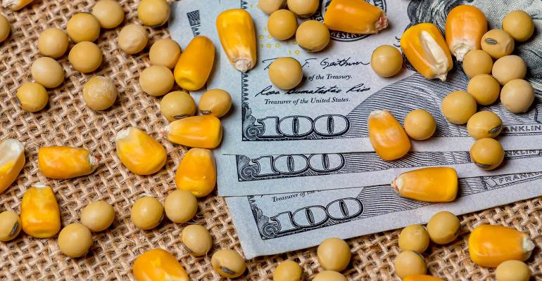 Corn and soybeans on 3 $100 bills
