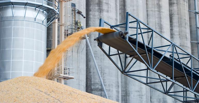 corn pouring off auger