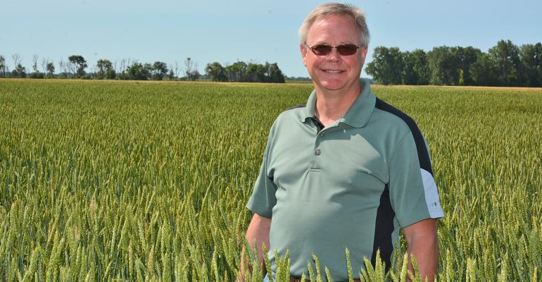 Craig LaPlante in field of heritage wheat