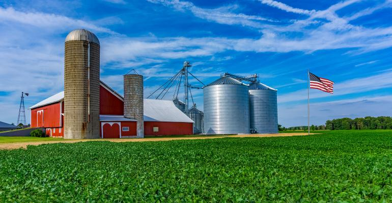 Midwest farm with spring crop and red barn,Indiana