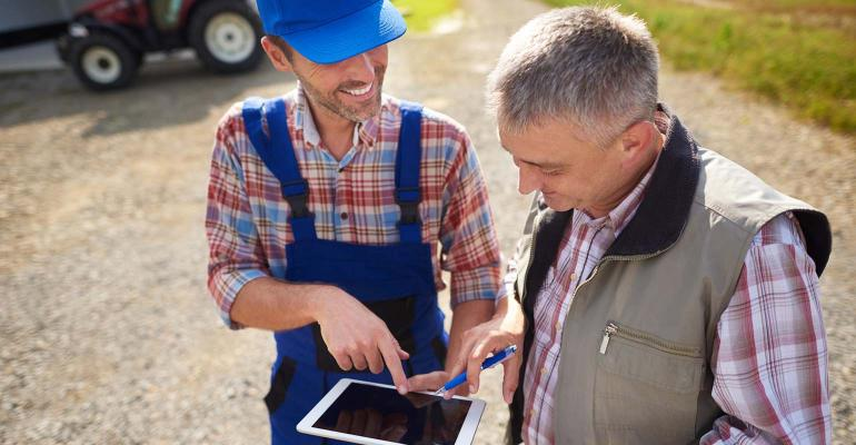 High angle view on modern farmers with digital tablet