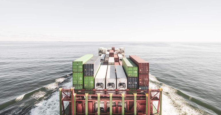 Barge on open water with shipping containers