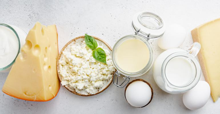 Assorted dairy products including milk, cream and cheese.