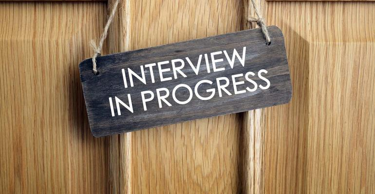 Interview in progress sign on door.