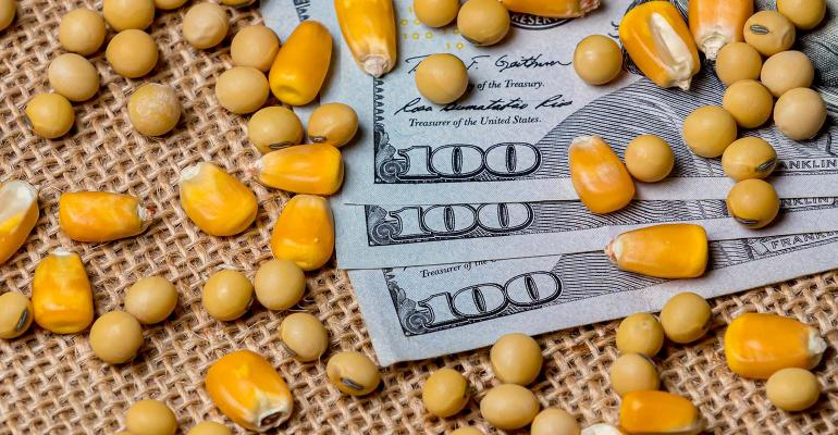 one hundred dollar bills with corn and soybeans