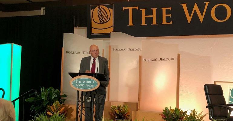 Robb Fraley stands at podium at World Food Prize event.