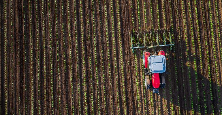 Aerial of tractor cultivating