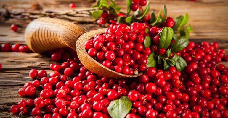 Cranberries on wooden table background