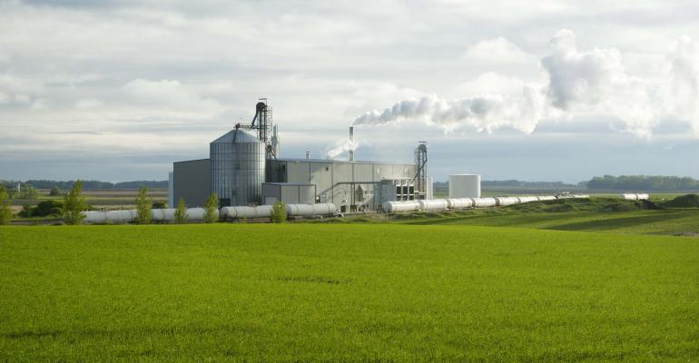 Ethanol plant beyond field of green