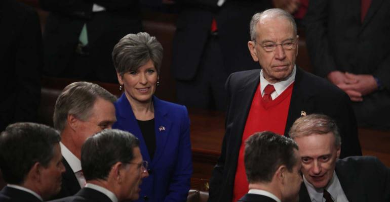 Sen. Jodi Ernst (R-IA) and Sen. Chuck Grassley (R-IA) talk prior to the State of the Union address in the chamber of the U.S. House of Representatives.
