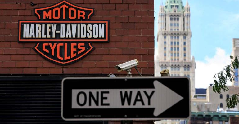 The Harley Davidson logo is displayed on the outside of the Harley-Davidson of New York City store.