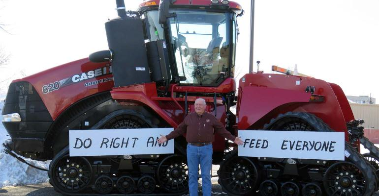 Sonny Perdue stands by 4WD tractor in North Dakota.