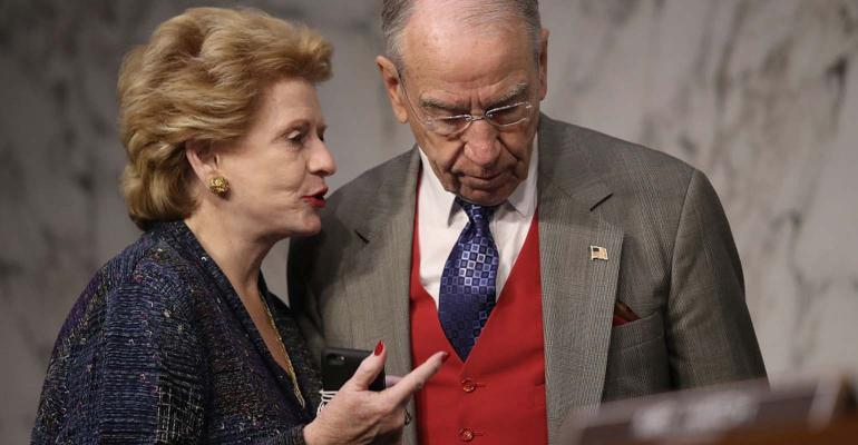 Sen. Debbie Stabenow (D-MI) speaks with Sen. Chuck Grassley (R).