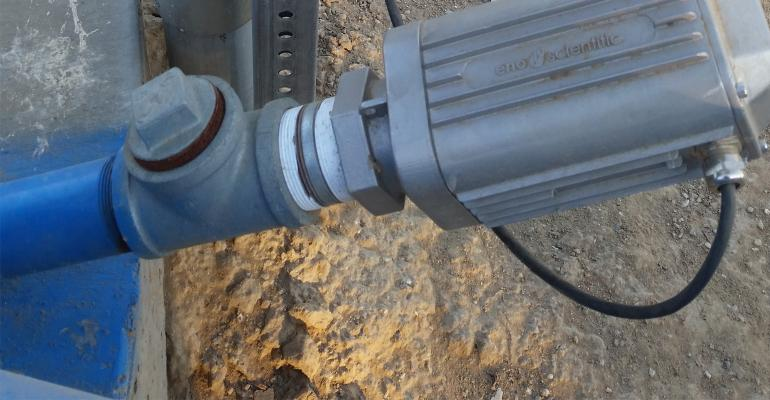 An Eno Scientific Well Watch 700 sonic water level indicator is mounted on an irrigation well