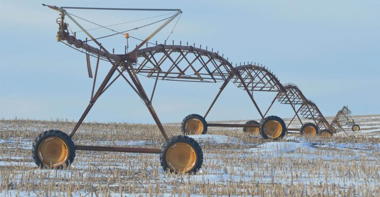 irrigation equipment in field with dusting of snow