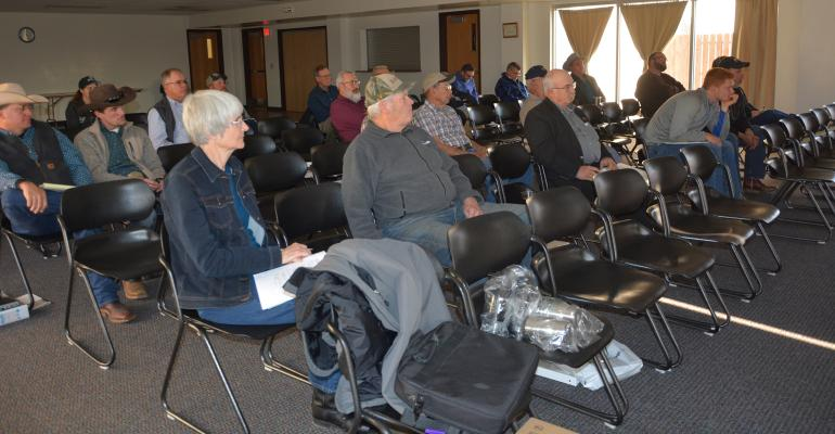 Cattle ranchers attend a conference