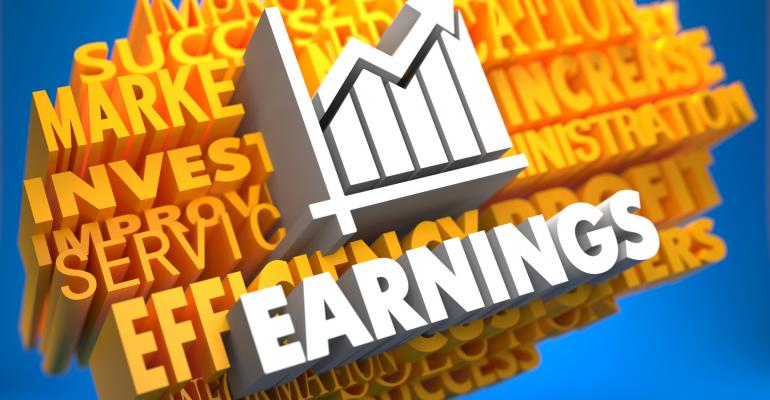 Earnings in white on background of yellow words