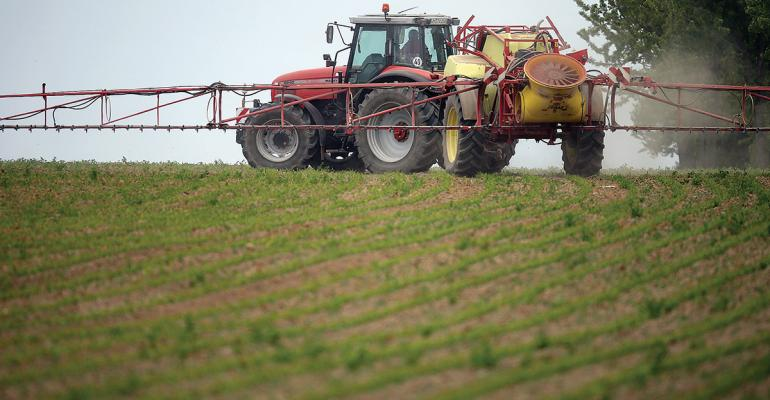 Herbicide sprayer spraying in field