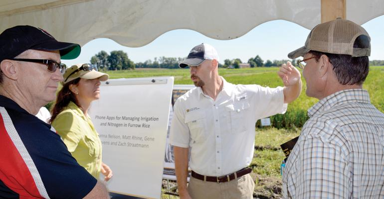 Matt Rhine meets with visitors to Fisher Delta Research Center Field Day.