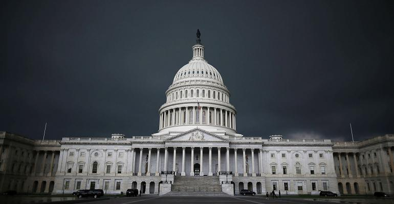 Dark storm clouds over the U.S. Capitol building