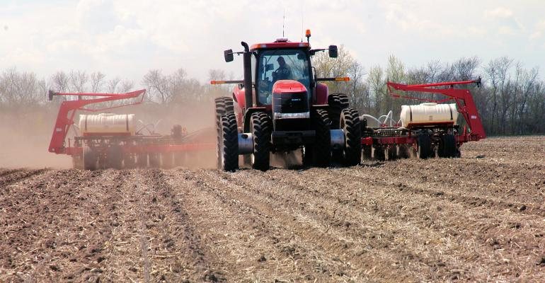 Tractor applying starter fertilizer at planting