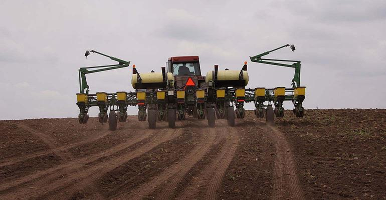 Planting corn with John Deere planter.
