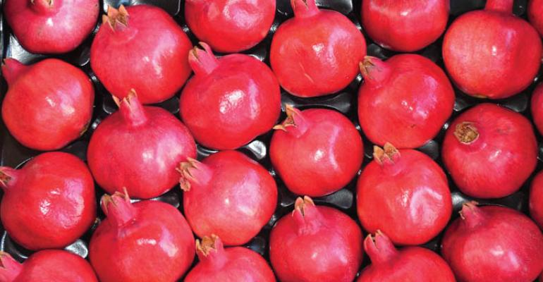 A box of premium bright Angel Red pomegranates ready for shipment