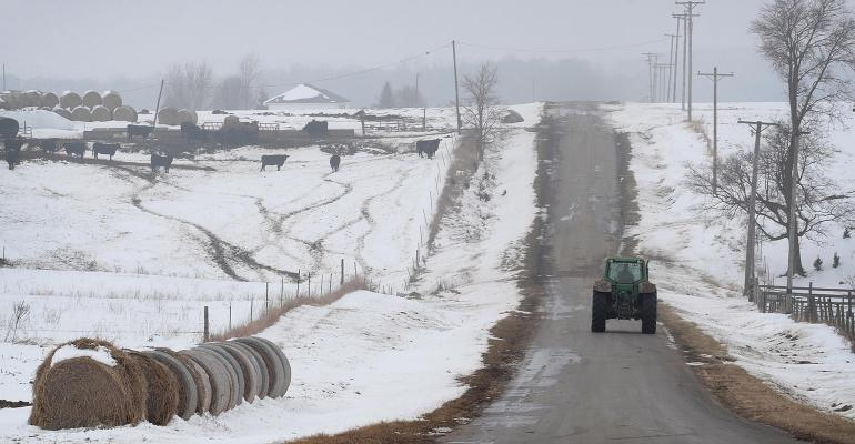 A farmer drives a tractor down a rural road on January 17, 2019 near Ottawa, Illinois.