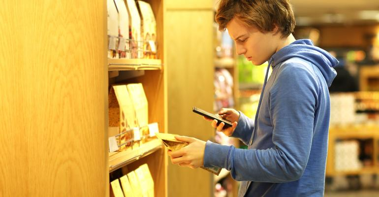Teenage male Shopper Reading Labels