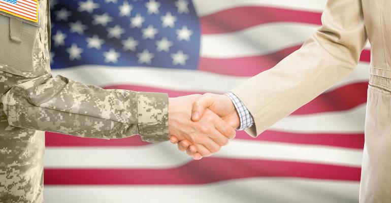 Soldier-Civilian-Flag-GettyImages-iStockphoto-675301570.jpg