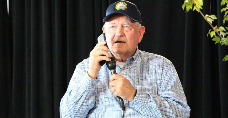 USDA Secretary Sonny Perdue takes a call from President Donald Trump during the 2019 Farm Progress Show.