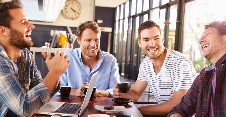Men talking, laughing at a coffee shop