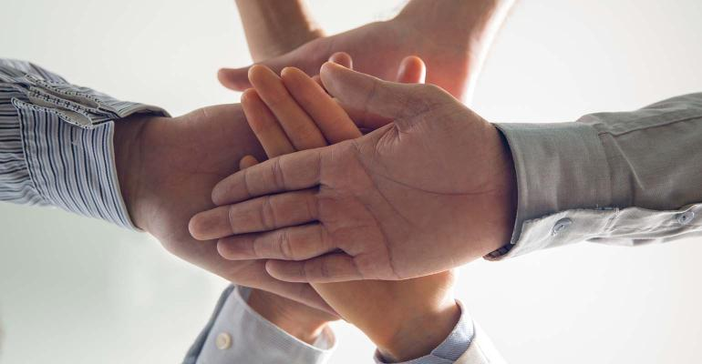 Close-up of stacked hands of business team,