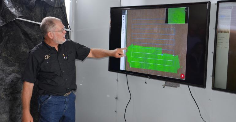 Bob Nielsen shows farmers where to watch for