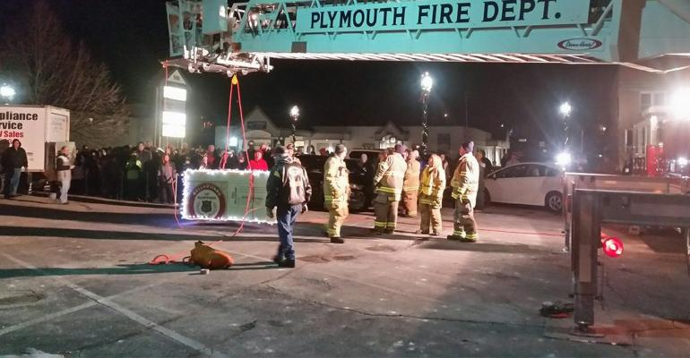 Sartori-branded 80-pound foam wedge lowered from 100-foot ladder on firetruck