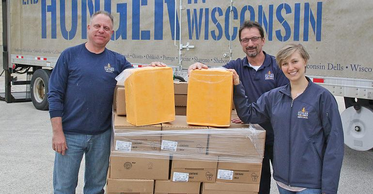Lee Knouse, Peter Vojvodich and Sarah Kikkert with 2 blocks of cheddar cheese