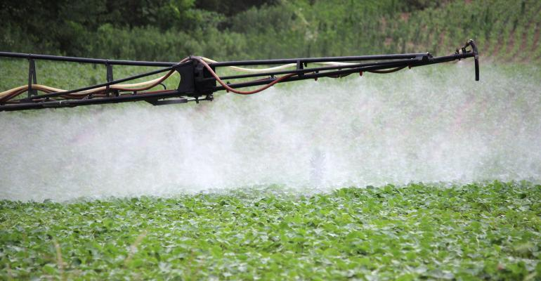 close-up of boom spraying soybeans