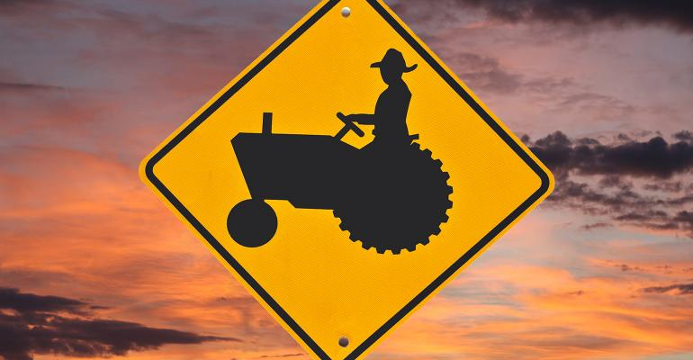 farmer on tractor safety sign