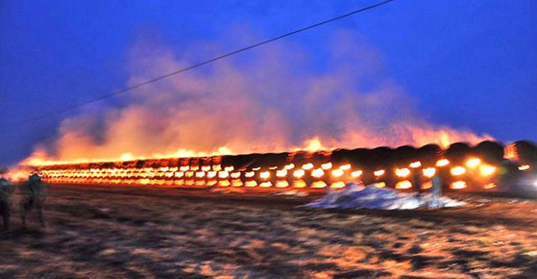 Cotton fire rages as round bales burn in gin yard — photos