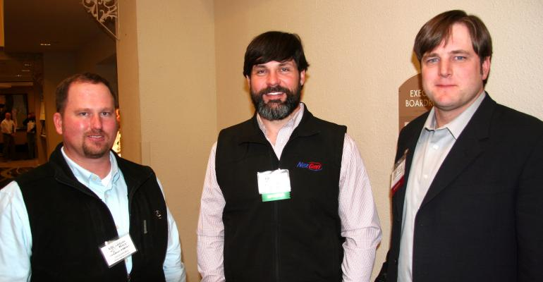 JASON BREWER left Ritter Agribusiness Chris Booker Americot and Nathan Reed cotton producer from Marianna Ark catch up on the latest developments in Arkansas agriculture at the National Conservation Systems Cotton and Rice Conference