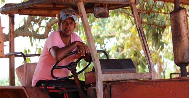 Tractor drivers keep these old tractors running on Cuban coop farms