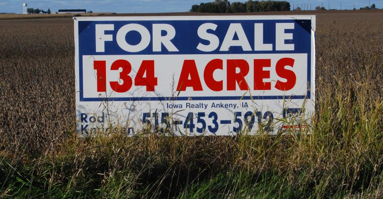 for sale sign in farmland
