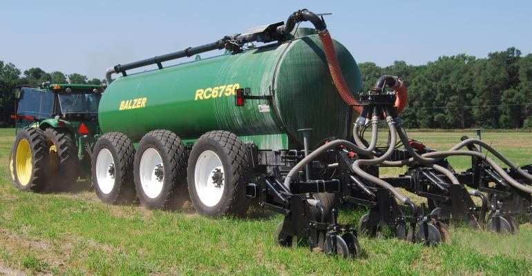 tractor spraying chemicals in field
