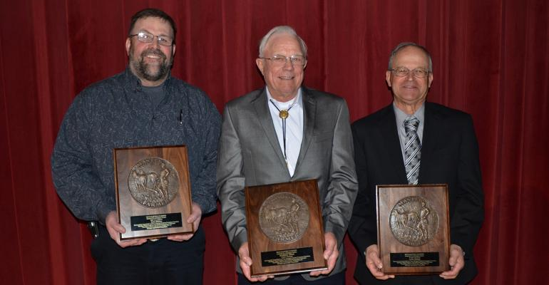 Ed Cagney of Scotts, Bob Ohse of Custer and Tom Braid of Durand holding Mater Farmer plaques