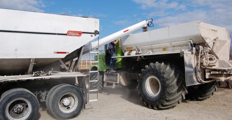 seed being loaded into fertilizer truck